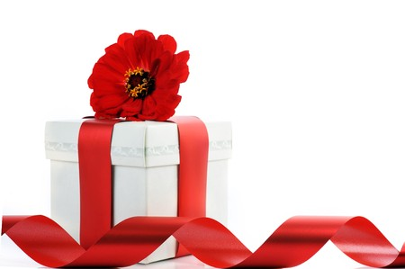 present with red ribbon and flower. Copy space ready to use  photo