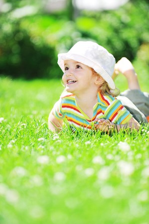little girl relaxing on grass photo