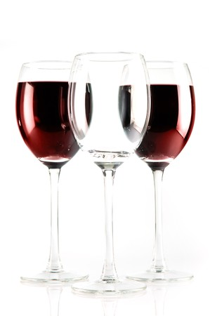 one empty glass and two with red wine photo