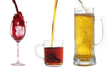 pour different drinks  into glasses photo
