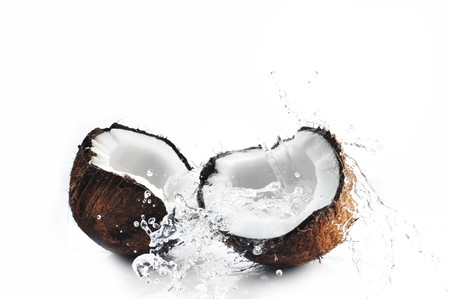 the coconut: Coco craqueado con big splash  Foto de archivo