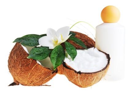 coconut oil: Noce di cocco e massaggio olio per il corpo close up Archivio Fotografico
