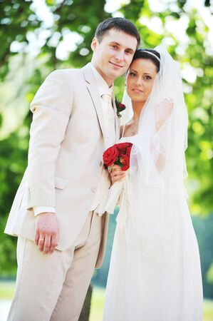groom and bride in white dress on background of green trees Stock Photo - 7683201