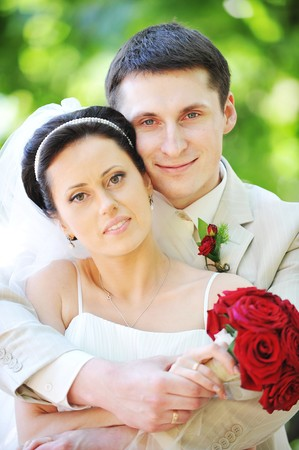 groom and bride in white dress on background of green trees Stock Photo - 7683207