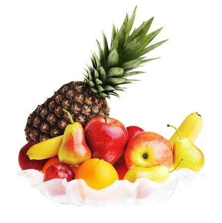 full glass vase of ripe tasty fruit  photo
