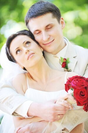 groom and bride in white dress on background of green trees Stock Photo - 7683292