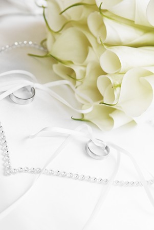 suspender: white flowers and wedding rings