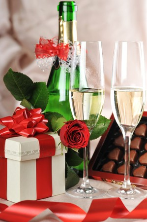 gift in box, champagne and red rose close-up photo