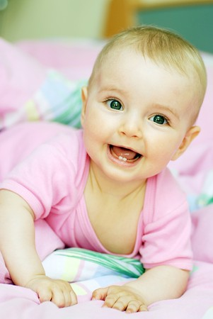 cheerful baby lies on stomach Stock Photo - 7683251