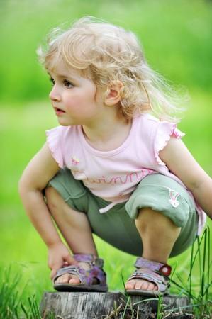 portrait little girl sitting. summer.  photo