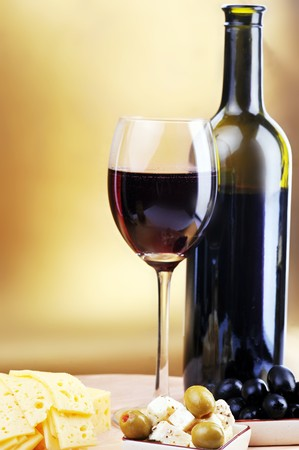 wine colour: wine bottle and cheese on gold background