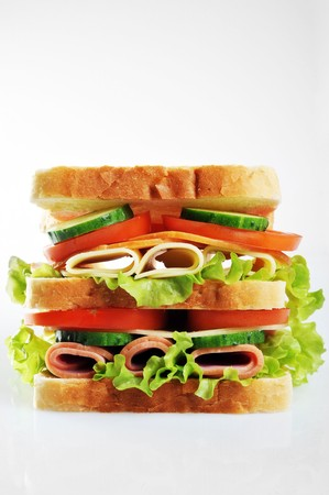 fresh and tasty sandwich with ham cheese and vegetables photo