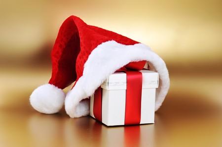 Christmas present with santa hat close up photo