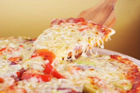 fresh baked pizza with pepperoni olives and peppers Stock Photo - 7778141