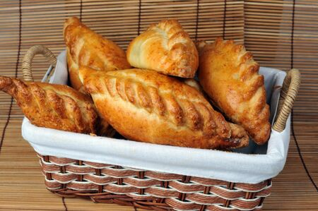 delicious fresh meat pies in  basket Stock Photo - 7834582