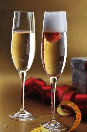 two shampagne glasses on celebratory table Stock Photo - 7936265