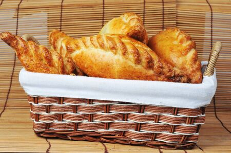 delicious fresh meat pies in  basket Stock Photo - 7936318