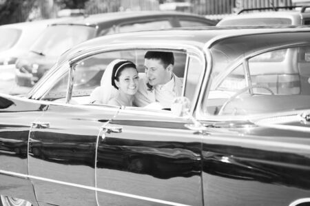 newlywed couple, groom  and bride,  in car Stock Photo - 8178430