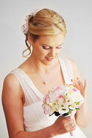 Studio portrait of beautiful stylish bride photo