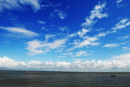 sky and clouds over  quiet sea photo