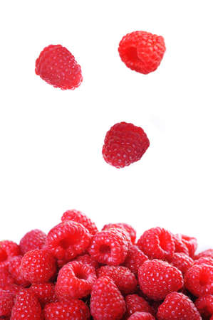 Ripe red raspberries close up photo