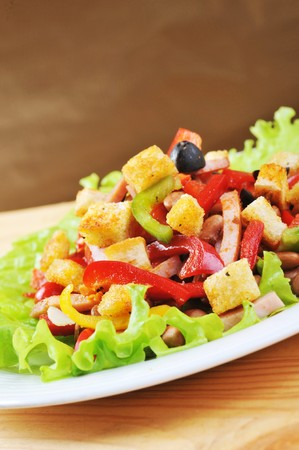 Fresh and tasty salad  on plate, wooden table photo