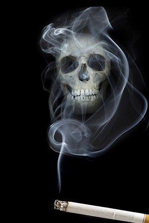 cancer drugs: human scull appears in cigarette smoke Stock Photo