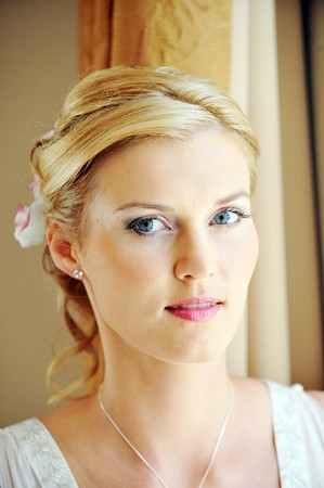 Studio portrait of beautiful stylish bride photo