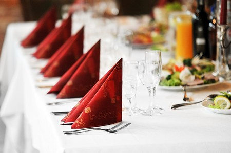 a marriage meeting: Wedding  reception place ready for guests.  table with food and drink Stock Photo