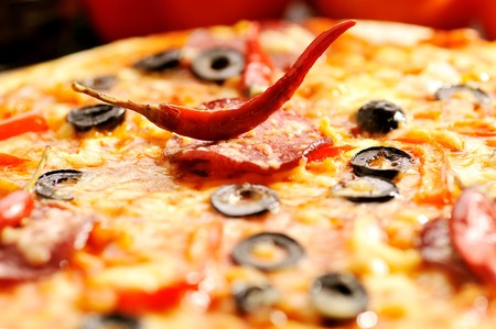 Close up of  pizza with tomatoes, cheese, black olives and  pepper Stock Photo - 8282848