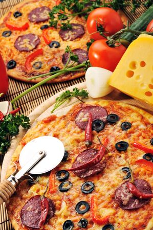 Close up of  pizza with tomatoes, cheese, black olives and  peppers. Stock Photo - 8282888