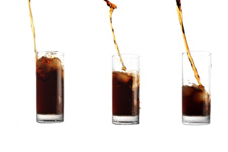 cola pour into glass on white background photo