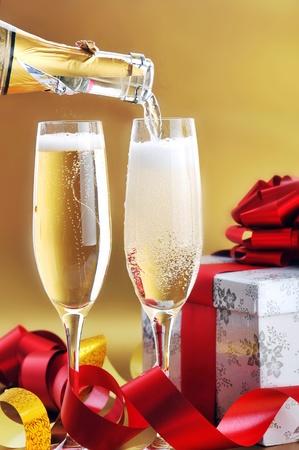 Champagne glasses on  celebratory table Stock Photo