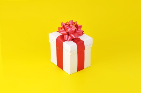 gift close up isolated on yellow background photo