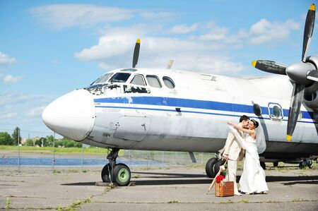destination wedding: groom and bride fly to wedding travel by  plane