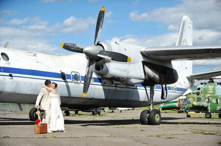 groom and bride fly to wedding travel by  plane photo