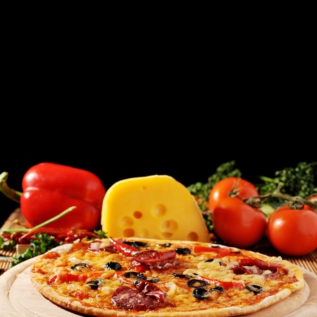 fresh baked pizza with  diferent ingredients photo