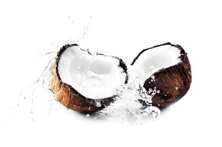 cracked coconut with big splash Stock Photo - 8609930