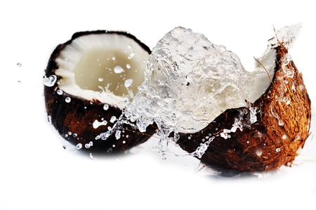 copra: cracked coconut with big splash Stock Photo