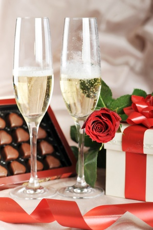 gift in box, champagne and red rose close-up Stock Photo