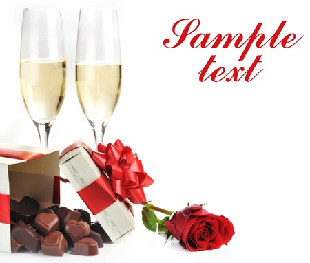 box of chocolates: beautiful red rose, champagne  and chocolate  close up