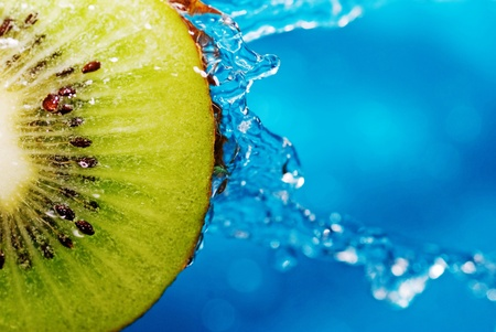 fruit in water: water drops on slice of kiwi Stock Photo