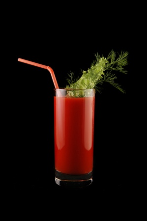tomato juice isolated on black photo