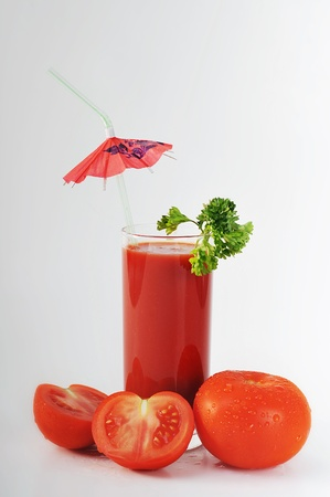 tomato juice in glass close up photo