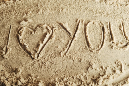 heart drawn in the smooth sand photo