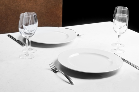 Tables set for  meal in  modern  restaurant photo