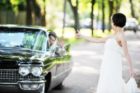 bride  near  car  after their wedding ceremony Stock Photo