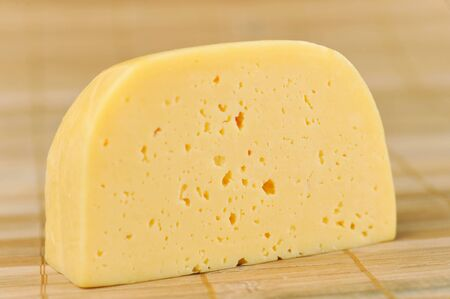 large piece of tasty  cheese isolated photo