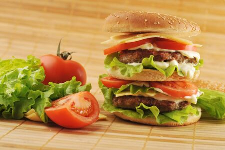 hamburger with cutlet and vegetables on bamboo napkin Stock Photo - 9083094