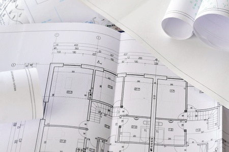 heap of design and project drawings on  table  background. photo